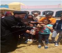 «كنيسة العذراء مريم» بالخارجة توزع الفوانيس على الأطفال