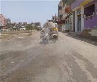 صور| سيارات لرش المياه لتخفيف درجات الحرارة بشوارع كفر الشيخ