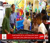 صور| السيسي يشارك أبناء الشهداء والأيتام فرحتهم بمنطقة الألعاب