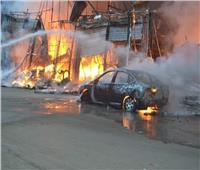 الدفع بـ10 سيارات إطفاء للسيطرة على حريق محلات بالهرم