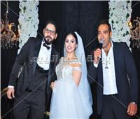 صور| عدوية وأوكا وأورتيجا يُشعلون زفاف «محمد ودينا»