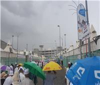 صور| أمطار غزيرة على المشاعر المقدسة بـ «منى»