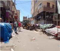 إزالة آثار الحريق بشارع مصر في الإسماعيلية