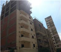 إزالة عدد من الأدوار المخالفة بأحد الأبراج السكنية في بنها