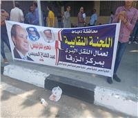 صور  عمال النقل البري بدمياط يؤيدون الرئيس السيسي