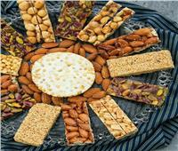 ما حكم شراء حلوى المولد النبوي والتهادي بها؟ «المفتي» يجيب