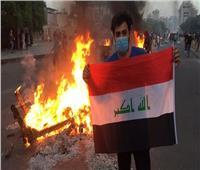 محتجون عراقيون يضرمون النار في مكاتب حزب سياسي
