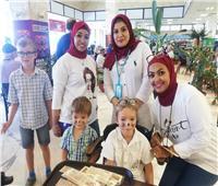 صور| مطار أسوان الدولي يحتفل مع المسافرين بـ«عيد الرعب»