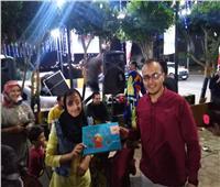 صور.. «شارع ٣٠٦»  يستقبل زائريه بأجواء الاحتفال بالمولد النبوي