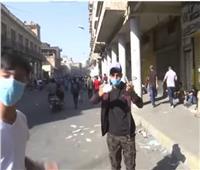 شاهد| اشتباكات بين الشرطة والمحتجين في بغداد