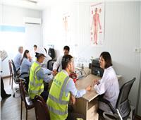 عيادة وشيف وملاعب.. كيف يقضي 2000 عامل صيني يومهم بالعاصمة الإدارية؟