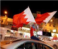 صور| شوارع المنامة تتزين بـ«الأحمر والأبيض» عقب تتويج البحرين بـ«خليجي 24»