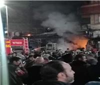 صور| إخماد حريق هائل في 3 محال بالإسكندرية