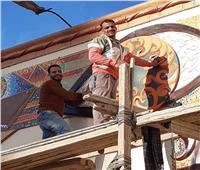 جامعة أسيوط تبدأ تجميل ميدان المحطة بجدارية «عين الحياة»