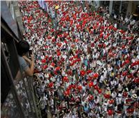 المئات يحتشدون في متنزه بوسط هونج كونج للمطالبة بالديمقراطية