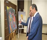 صور| الحاج علي يفتتح جناح للفن التشكيلي بمعرض الكتاب