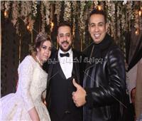 صور| الليثي وطارق عبد الحليم يحتفلان بزفاف «هشام ونرمين»