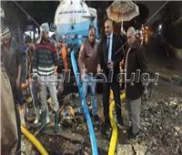 صور| تكدس مروري بسبب كسر ماسورة مياه بشارع التحرير بالدقي