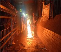 المصريون يشعلون نيران التنين في الشوارع للتدفئة
