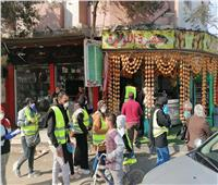 أصحاب الهمم يوزعون كمامات وحملة للتوعية من فيروس كورونا