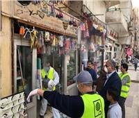 حملة تعقيم للمحلات والشوارع في الدقي