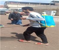 «شباب شبرا الخيمة» يعقمون الشوارع والميادين لمواجهة فيروس كورونا
