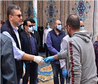 صور| إجراءات احترازية في جنازة حماة عمرو الليثي