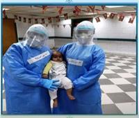 «الجيش الأبيض» يحتفل بسبوع طفل في مستشفى العزل| فيديو
