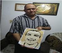 شيف بالغردقة يصمم صورة للشهيد أحمد المنسى من حبات الأرز