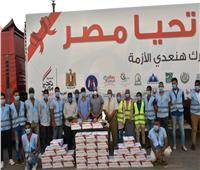 محافظ أسوان يشهد توزيع 10 آلاف كرتونة مواد غذائية من صندوق تحيا مصر