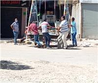 رجال الأمن يسيطرون على الشوارع الرئيسية ببولاق الدكرور لضبط الخارجين عن الحظر