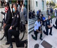 كيف استقبل المتظاهرون الأمريكيون صور ركوع الشرطة الأمريكية على ركبتهم؟