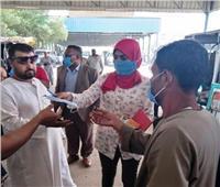 توزيع أعداد كبيرة من الكمامات على السائقين والمواطنين مجاناً بأسوان