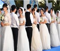بالصور | الصين تُكرم محاربي كورونا بحفل زفاف جماعي