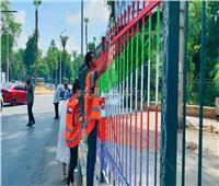 صور| مبادرة شبابية لتجميل شوارع وأسوار ميدان الجيزة