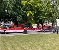 صور و فيديو  | بعلم 30 متر.. بيت العائلة المصرية فى لندن يحتفل بذكرى 30 يونيو