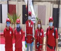 الهلال الأحمر المصري يساعد المواطنين في الانتخابات أمام الملك فهد بمدينة نصر