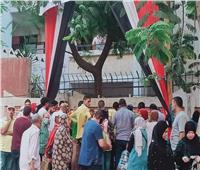 فيديو| علي أبواب لجان الانتخابات .. كمامات وجل لتعقيم الناخبين