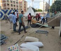 صور| مساعدات مالية ومعسكر لإيواء متضرري العقار المائل في الإسكندرية