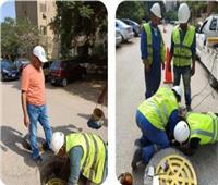 صور   تركيب شبكات حماية للمواطنين تحت أغطية بالوعات الصرف في الهرم