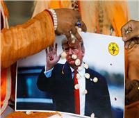 صور| نشطاء بالهند يصلون من أجل فوز ترامب