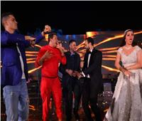 حمو بيكا بملابس حمراء في زفاف هنادي مهنا