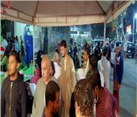 صور | رغم الأمطار..طوابير الناخبين أمام لجنة معهد الصحافة ببولاق.. فيديو