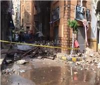 انتشال مصابين وجثتي طفلين من عقار الإسكندرية المنهار 