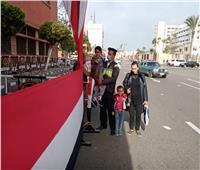 الشرطة تساعد ذوي الاحتياجات للإدلاء بأصواتهم بانتخابات النواب ببورسعيد
