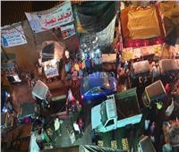 أهالي شارع الوحدة محاصرون بالباعة وإشغالات الطريق.. صور