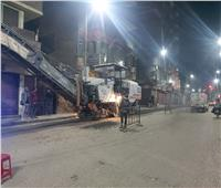كشط شارعي توفيق خشبة و26يوليو بأسيوط استعدادا لرصفهما