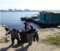 تكثيف أعمال النظافة بمرسى المعدية في غرب أسوان