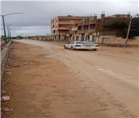 رفع كفاءة شوارع حي الزهور بمطروح بعد موجه الطقس السيئ