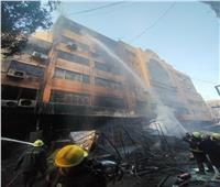 النيابة تعاين محلات سوق التوفيقيةبعد الحريق